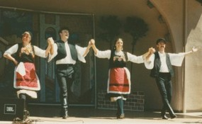 Greek dancers performing Syrtos at a festival