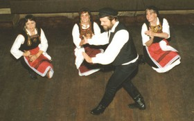 Greek folk dancer performing Zeibekikos at a party