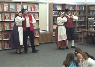 Performing a folk dance at a library