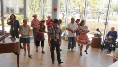Teaching an American folk dance to seniors